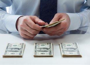 Welche Gebühren fallen beim Dollar Währungstausch an?